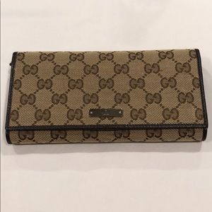 Authentic Gucci Monogram Canvas and Leather wallet